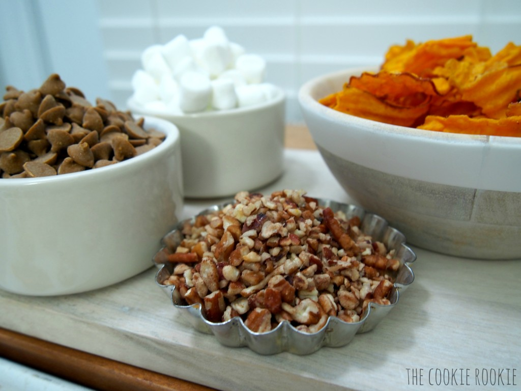 sweet potato chips dipped in cinnamon white chocolate and topped with marshmallows and pecans! my favorite side dish in snack form! loaded sweet potato chips!