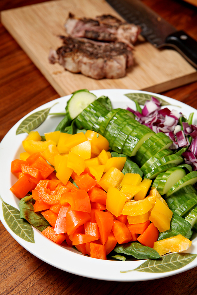 Steak and Sweet Pepper Salad | Summertime salads are delicious, especially when they call for all kinds of fresh vegetables. This salad calls for fresh spinach, sweet peppers, cucumber, red onion and steak, then is topped with a simple mustard vinaigrette! What's not to love?