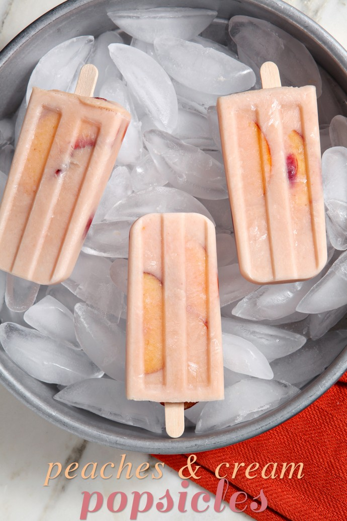 Cool down this August with slightly sweet and dreamy Peaches and Cream Popsicles! Sprinkle sliced peaches with sugar, letting them steep in the beautiful liquid. Strain the peaches and save the juices... then combine the juice with Greek yogurt and a few peaches to create these decadent popsicles!