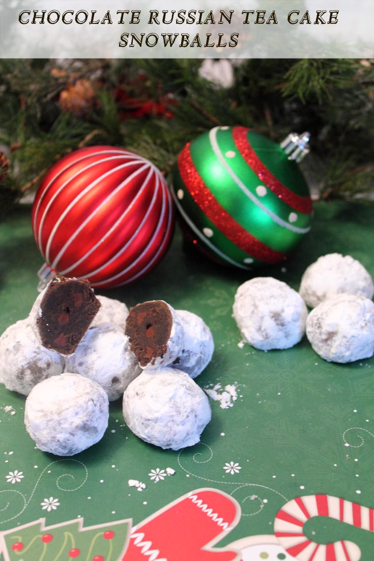 Chocolate Russian Tea Cake Snowballs 2 - Fun & simple to make, these snowballs are chock full of chocolate and chocolate chips then covered with powdered sugar. Perfect for the holidays!