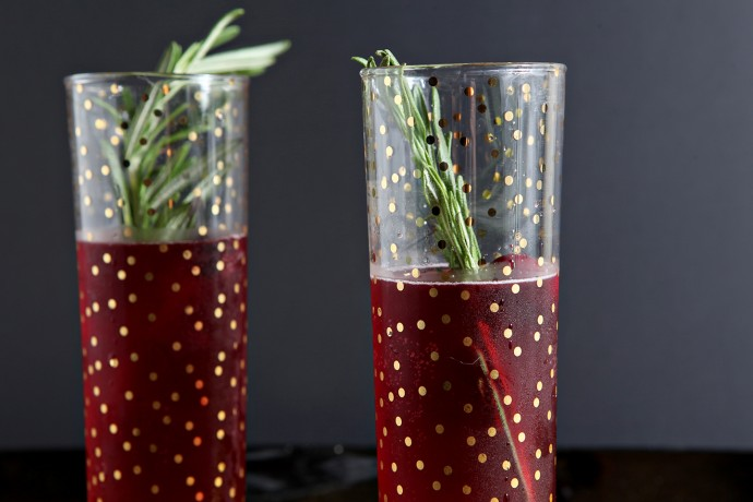 Ring in the new year by making these seasonal Cranberry Bellinis! Unsweetened cranberry juice is combined with simple syrup and prosecco to make these create these festive cocktails that are perfect for New Year's Eve!